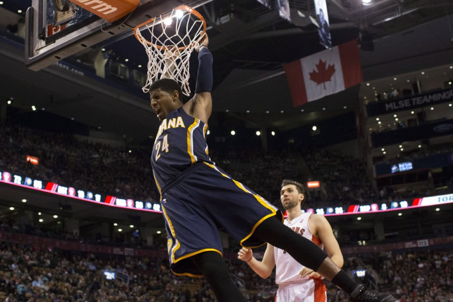 Paul George inscrit sur ce dunk 2 de... (Photo Chris Young, La Presse Canadienne)