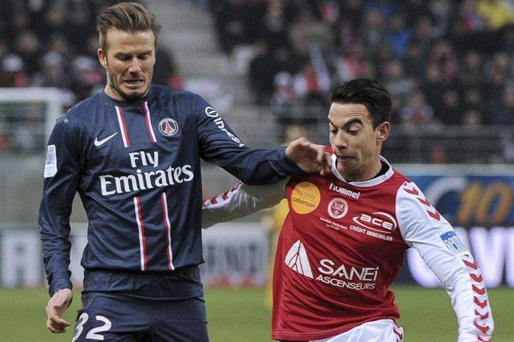David Beckham et Diego Rigonato.... (Photo Philippe Huguen, Agence France-Presse)