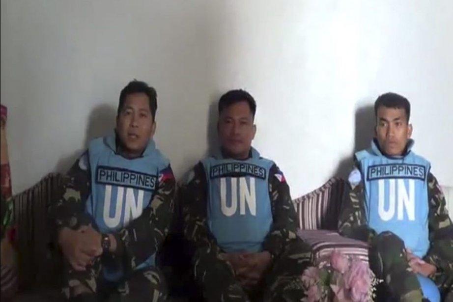 Une image d'un vidéo sur YouTube montre trois... (Photo Agence France-Presse)