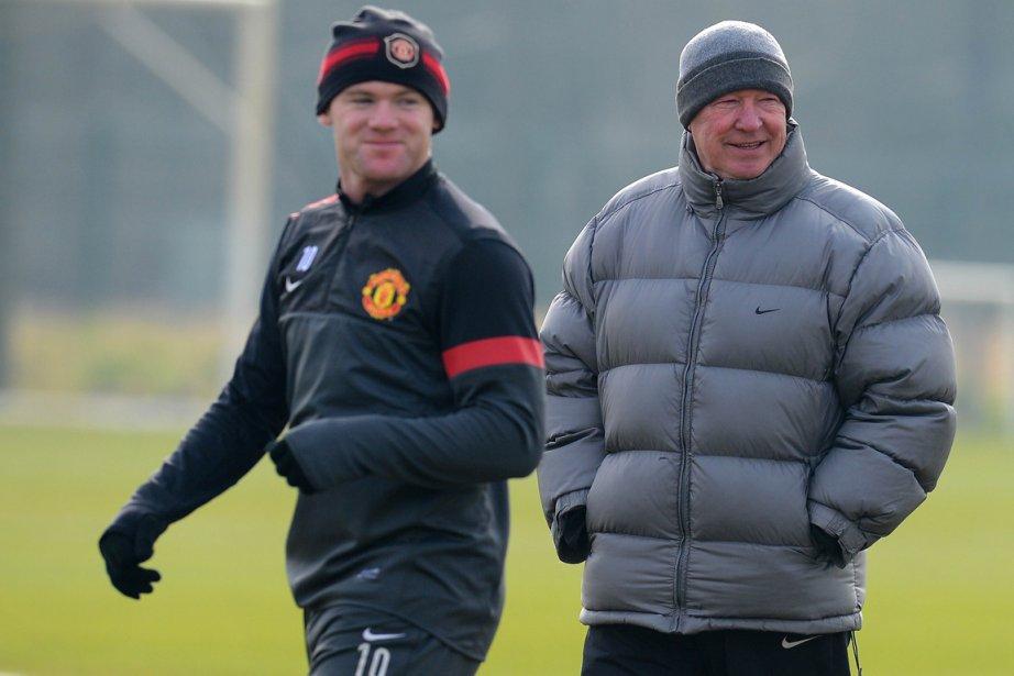 Wayne Rooney et l'entraîneur de Manchester United, Alex... (Photo Andrew Yates, AFP)