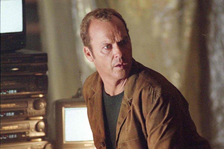 Michael Keaton dans le film White Noise.... (Photo Universal)