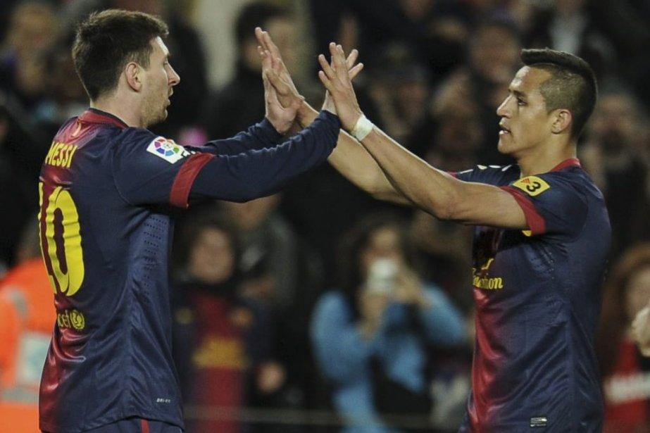 Lionel Messi et Alexis Sanchez.... (Photo Lluis Gene, Agence France-Presse)