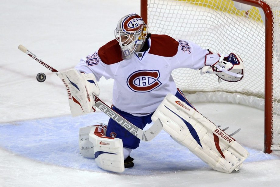 Peter Budaj effectue un arrêt. (PHOTO RHONA WISE, REUTERS)