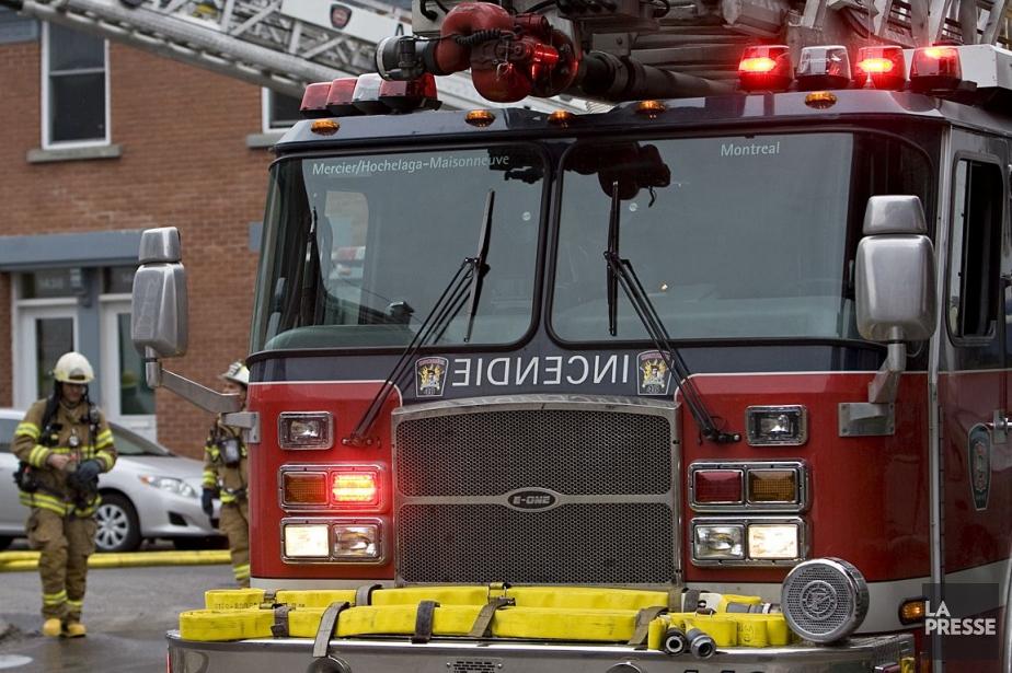 Environ 70 pompiers ont mis près de... (Photo David Boily, archives La Presse)