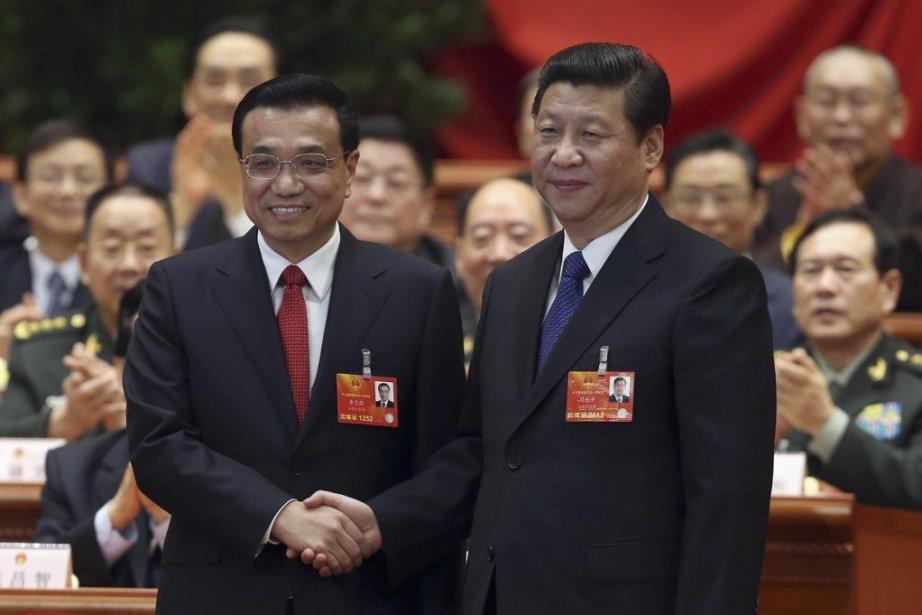 Li Keqiang etXi Jinping.... (Photo Reuters)
