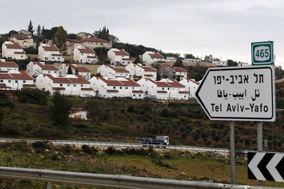 Des maisons d'une colonie juive qui s'est installée... (Photo: Reuters)