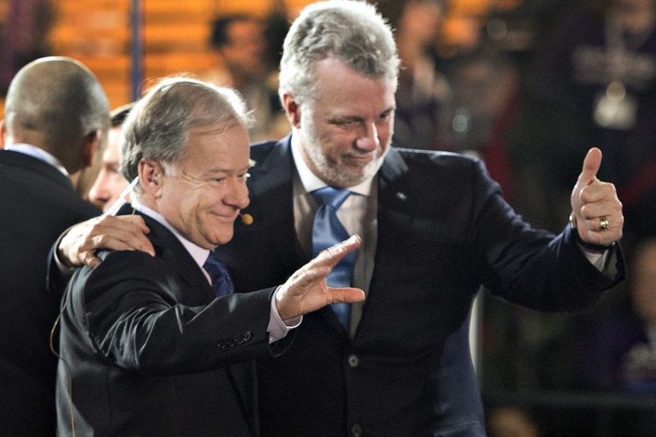 Raymond Bachand et Philippe Couillard.... (Photo Ryan Remiorz, La Presse Canadienne)