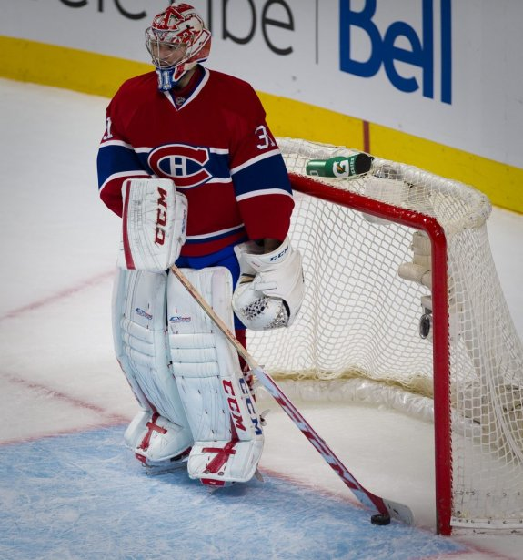 Carey Price retire la rondelle de son filet après le but de Myers. | 19 mars 2013