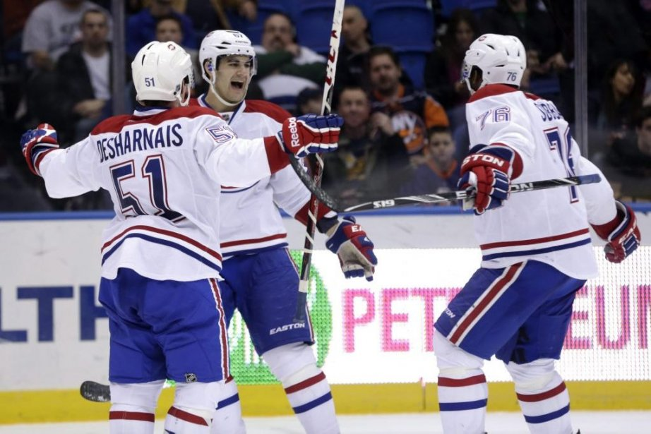 Montreal Canadiens' David Desharnais, left, Max Pacioretty, center,...