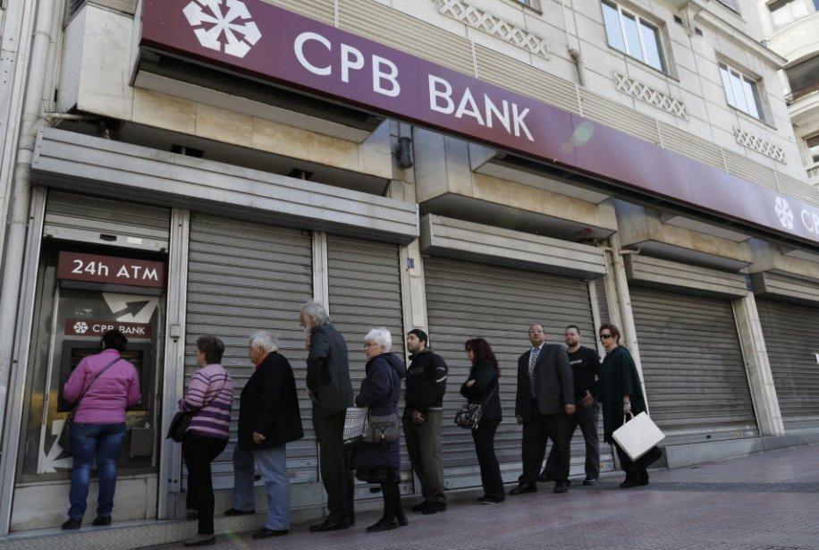 Les politiciens chypriotes apportaient les dernières retouches, vendredi, à un...