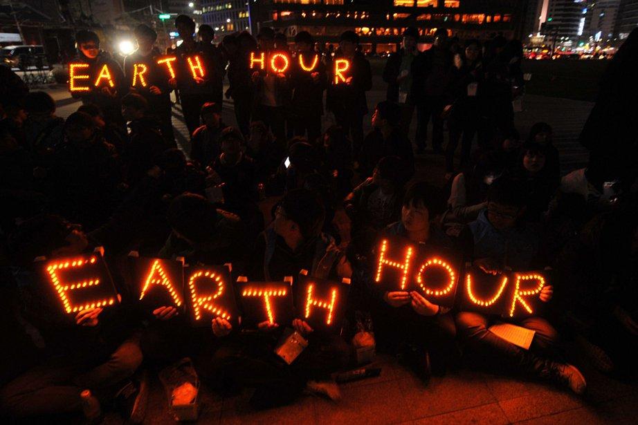 Des Sud-Coréens participent à leur façon à l'événement... (Photo: AFP)