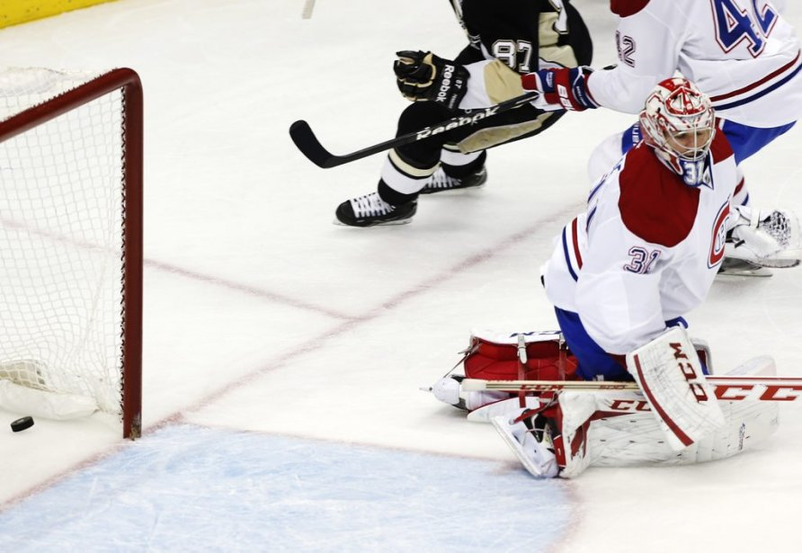 Le tir de Sidney Crosby déjoue Carey Price (31). (PHOTO JASON COHN, REUTERS)