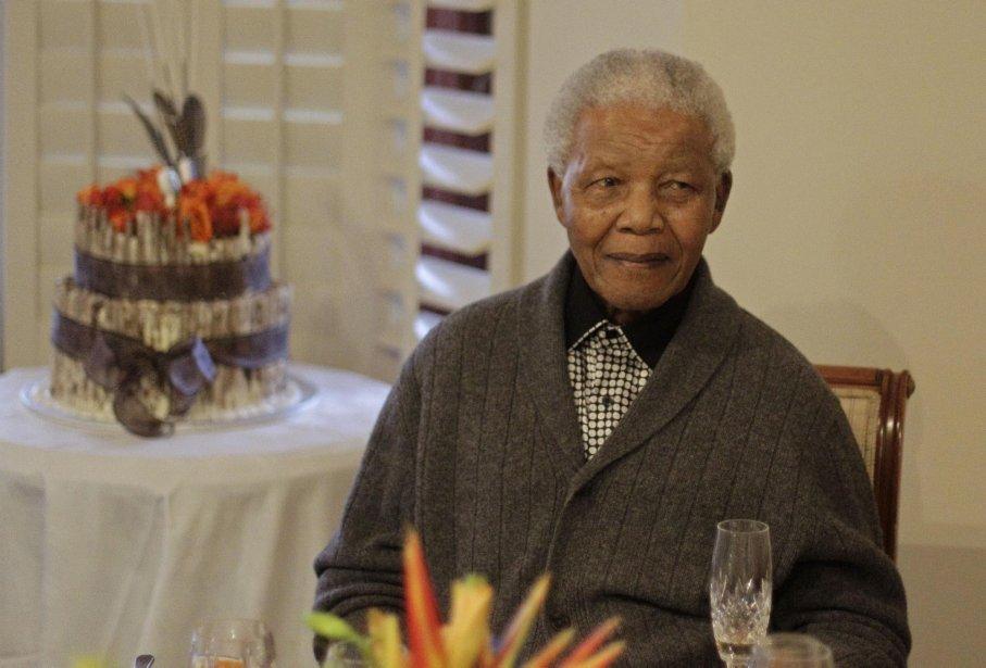 Nelson Mandela a un«bon moral» et fait «des... (Photo Schalk van Zuydam / AFP)