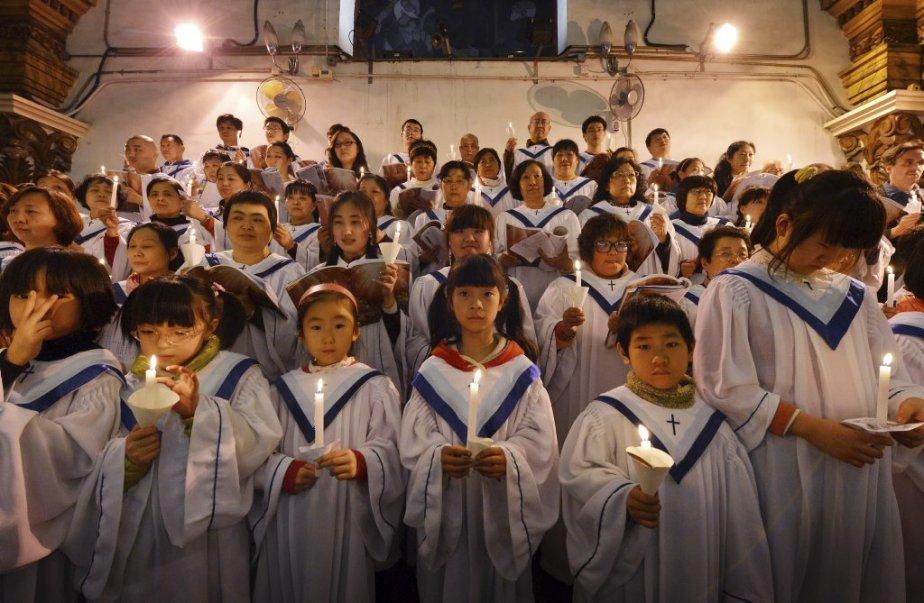 Selon les experts, il y aurait quelque 12 millions de catholiques en Chine. Sur la photo, un choeur s'apprête à chanter à la Cathédrale de l'Immaculée-Conception de Pékin. | 31 mars 2013