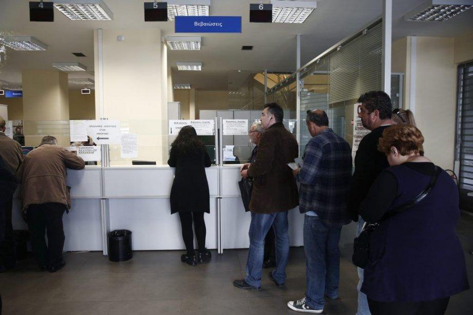 File d'attente dans un bureau de l'assurance-emploi à... (Photo AFP)