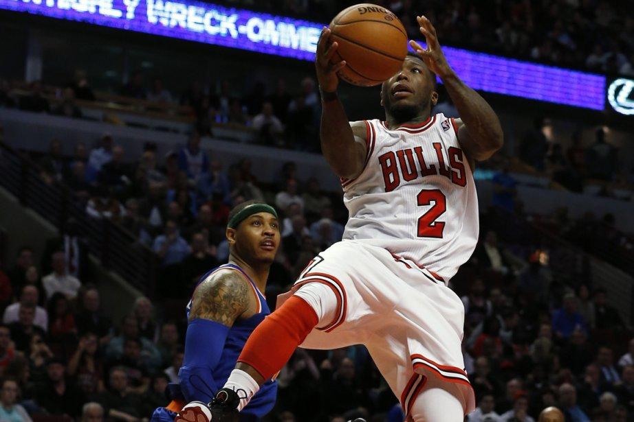 Nate Robinson (à droite) a inscrit 35 points... (Photo Jim Young, Reuters)