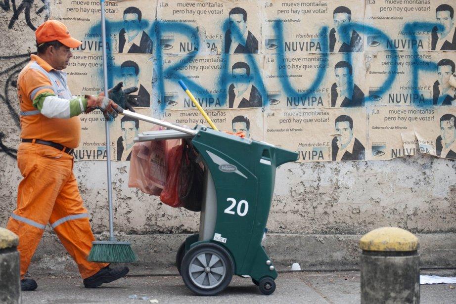 Battu d'une courte tête lors du scrutin, Henrique... (PHOTO RAUL ARBOLEDA, AFP)