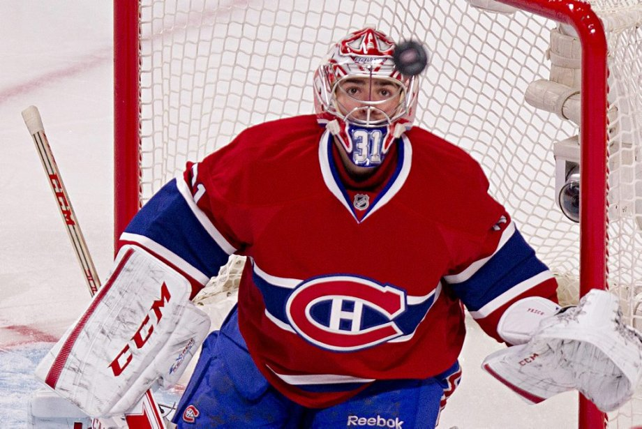 Carey Price suit la rondelle des yeux. | 20 avril 2013