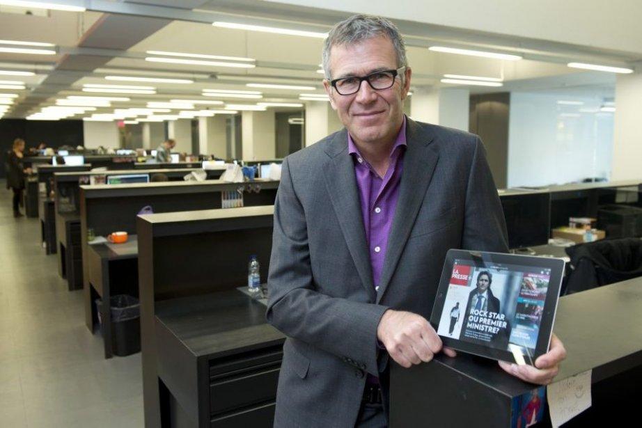 Guy Crevier présentant La Presse+.... (Photo La Presse Canadienne)