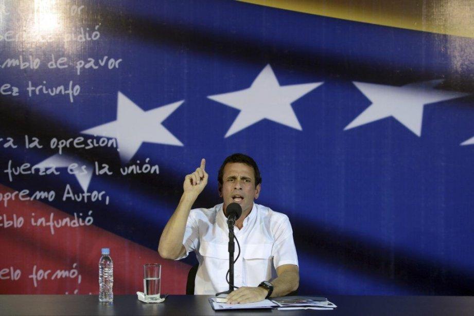 M.Capriles, qui affirme que l'élection a été marquée... (PHOTO LEO RAMIREZ, AFP)