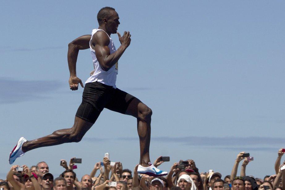 Tous les athlètes jamaïcains y compris ceux, comme... (Photo Felipe Dana, AP)