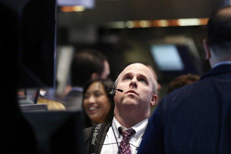 Wall Street et Bay Street ont terminé en nette baisse... (Photo Reuters)