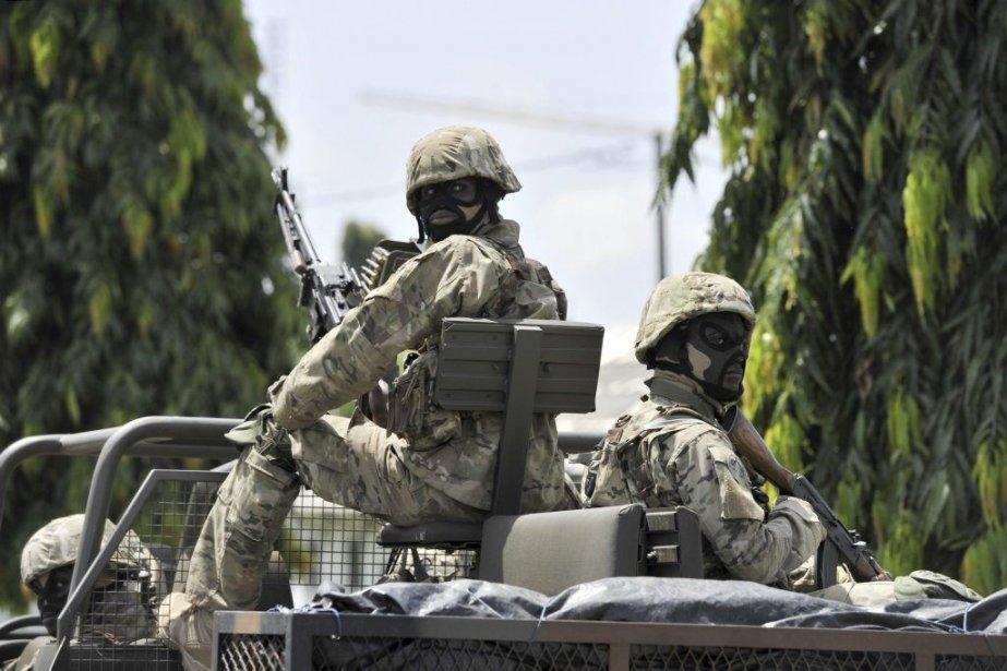 Les FRCI (sur la photo) sont constituées en... (PHOTO ISSOUF SANOGO, AFP)
