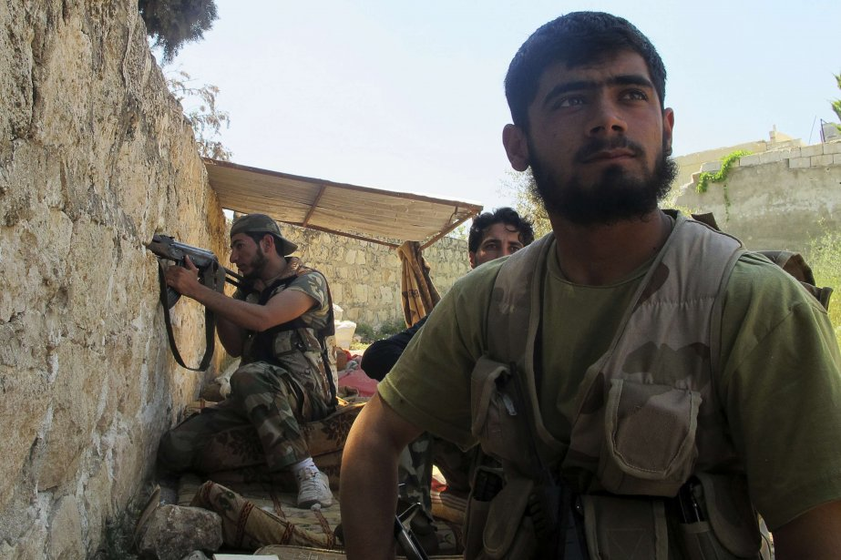 Soldats de l'Armée de libération syrienne.... (Photo Abdalghne Karoof, Reuters)
