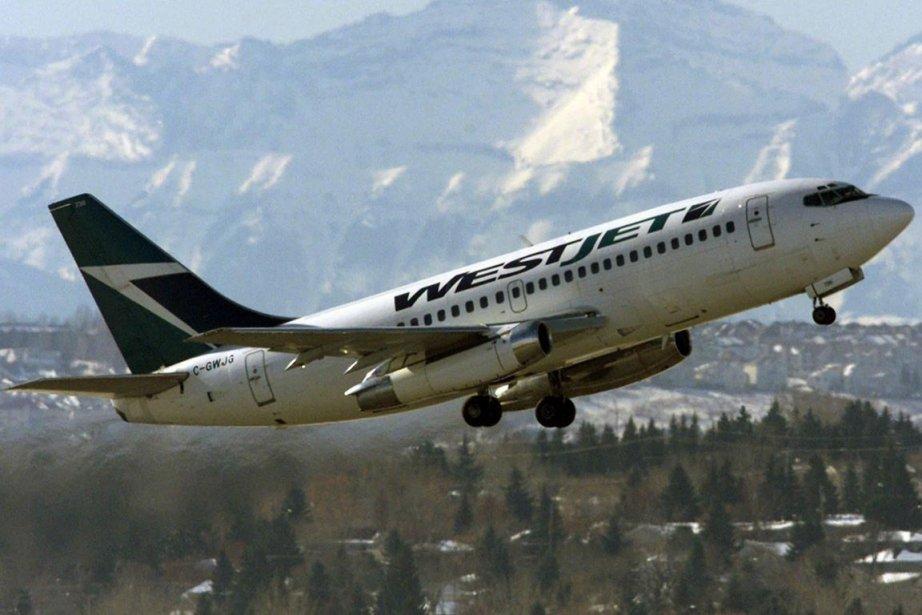 Un avion de la compagnie WestJet... (PHOTO ARCHIVES PC)