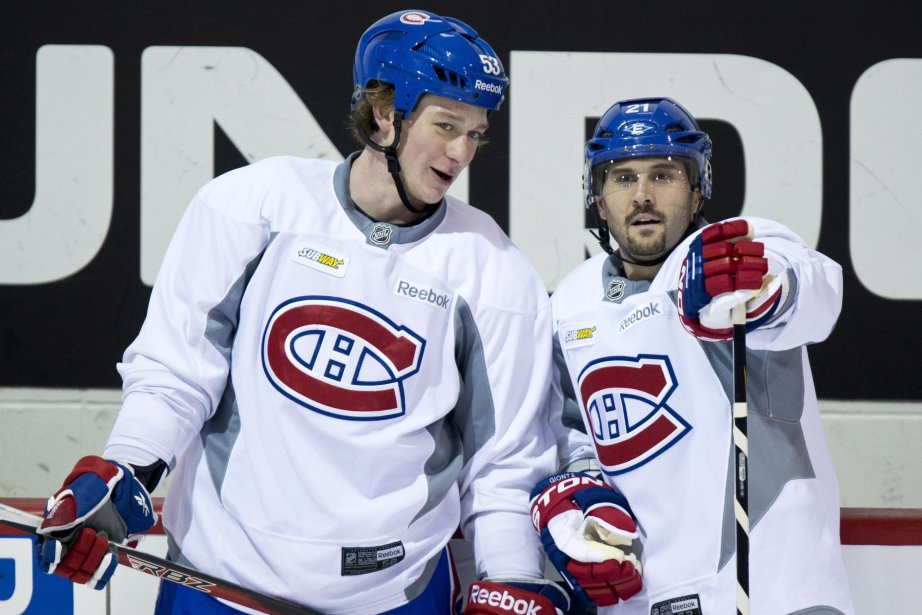 Ryan White et Brian Gionta... (Photo Paul Chiasson, La Presse Canadienne)