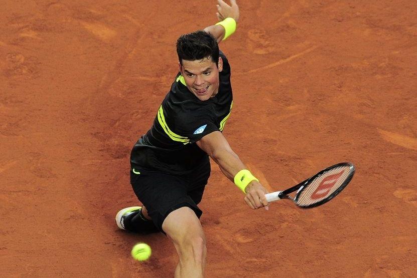 Milos Raonic... (Photo Manu Fernandez, Associated Press)