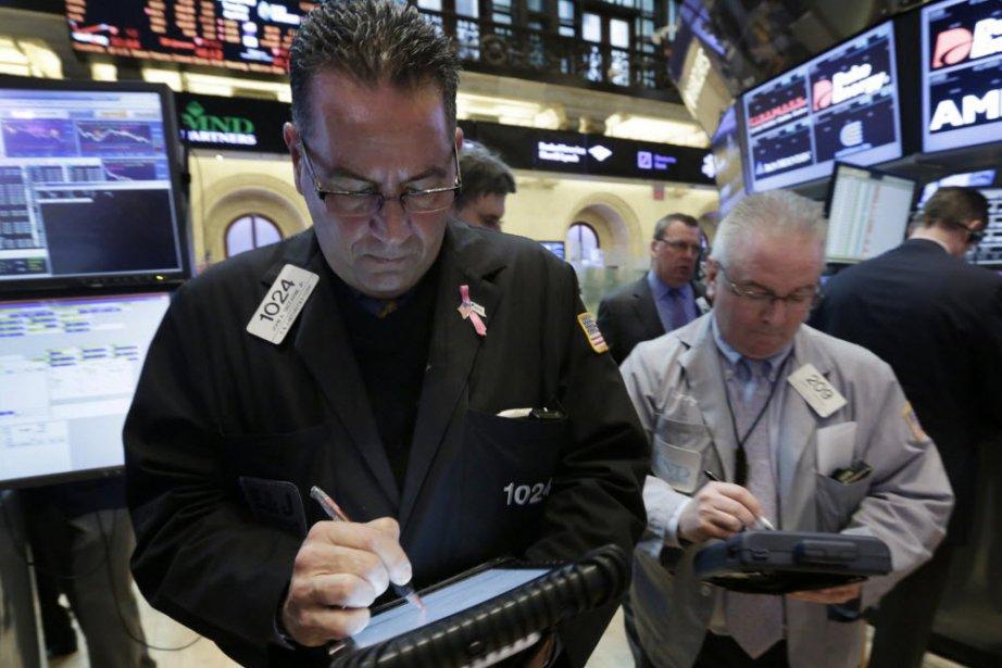 Le Dow Jones, l'indice vedette de Wall Street qui a franchi la veille le seuil...