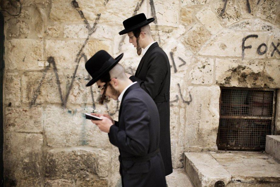 La loi israélienne autorise les juifs à prier... (PHOTO MARCO LONGARI, AFP)