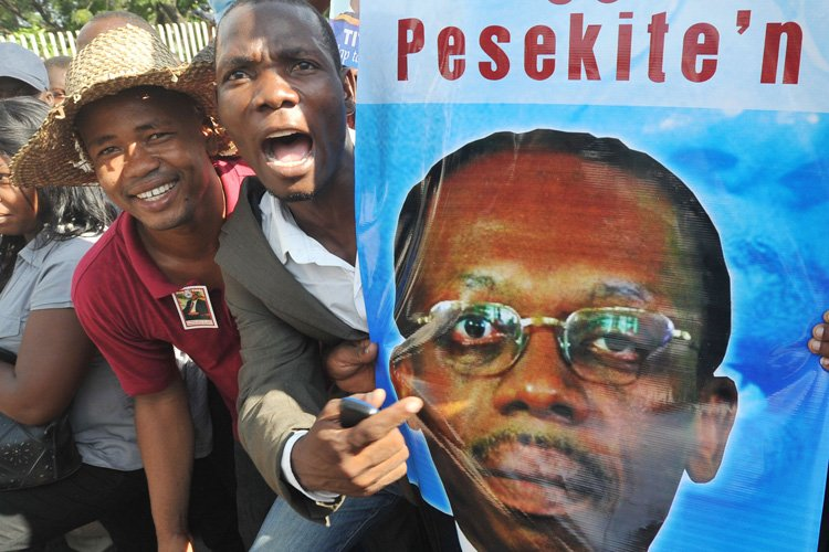 L'ancien président d'Haïti Jean-Bertrand Aristide a été entendu... (Photo: AFP)
