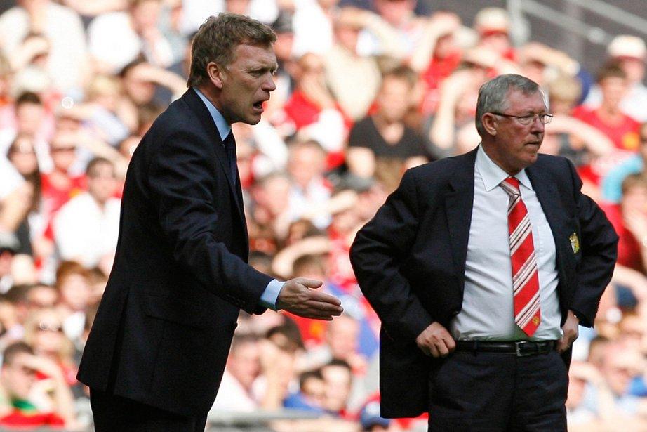 L'entraîneur David Moyes (à gauche) succédera à Alex... (Photo Ian Kington, archives AFP)