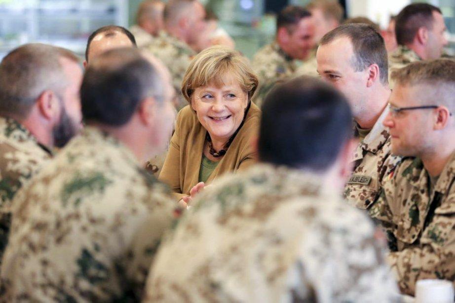 Cette visite surprise de la chancelière Angela Merkel... (Photo AFP)