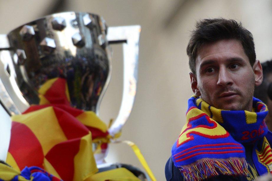 Lionel Messi souffre d'une blessure à la cuisse... (Photo Lluis Gene, AFP)