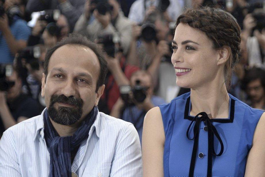 Le réalisateur iranien Asghar Farhadi en compagnie de... (Photo: AFP)