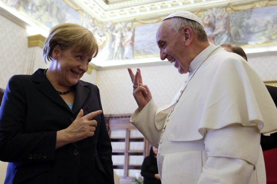 La chancelière allemande Angela Merkel et le pape... (Photo : Gregorio Borgia, AFP)