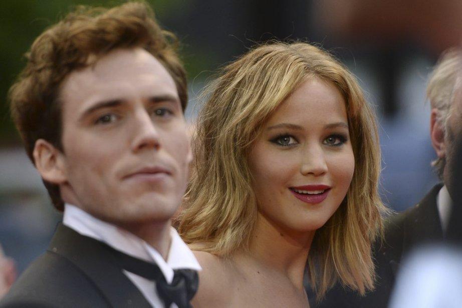 L'actrice américaine Jennifer Lawrence, gagnante d'un Oscar, en compagnie de l'acteur britannique Sam Claflin. | 18 mai 2013