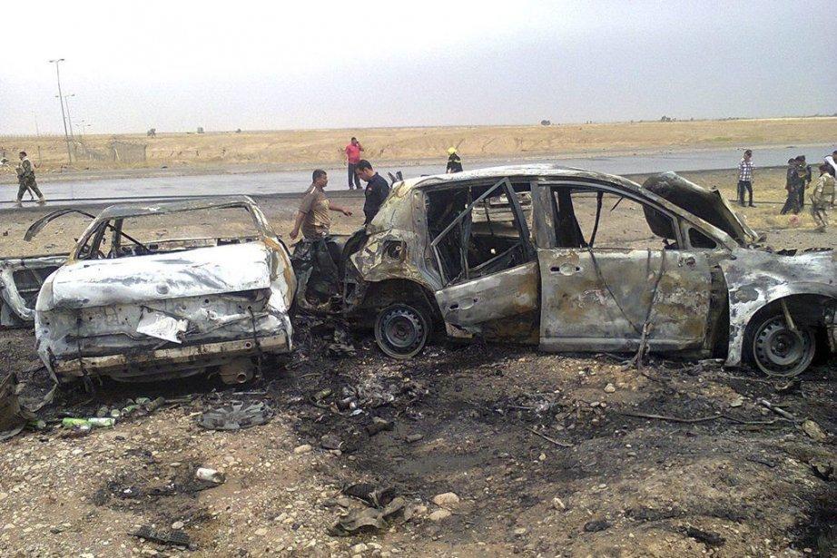 Une voiture piégée a explosé à proximité d'un... (PHOTO MAHMOUD AL-SAMARRAI, AFP)