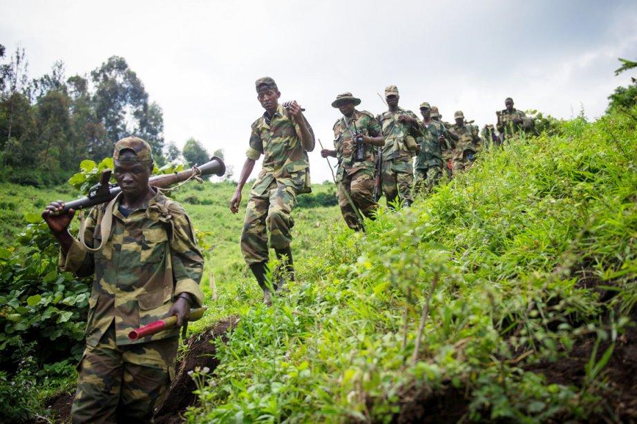 Des rebelles du M23 se déplacent dans l'est... (PHOTO PHIL MOORE, ARCHIVES AFP)
