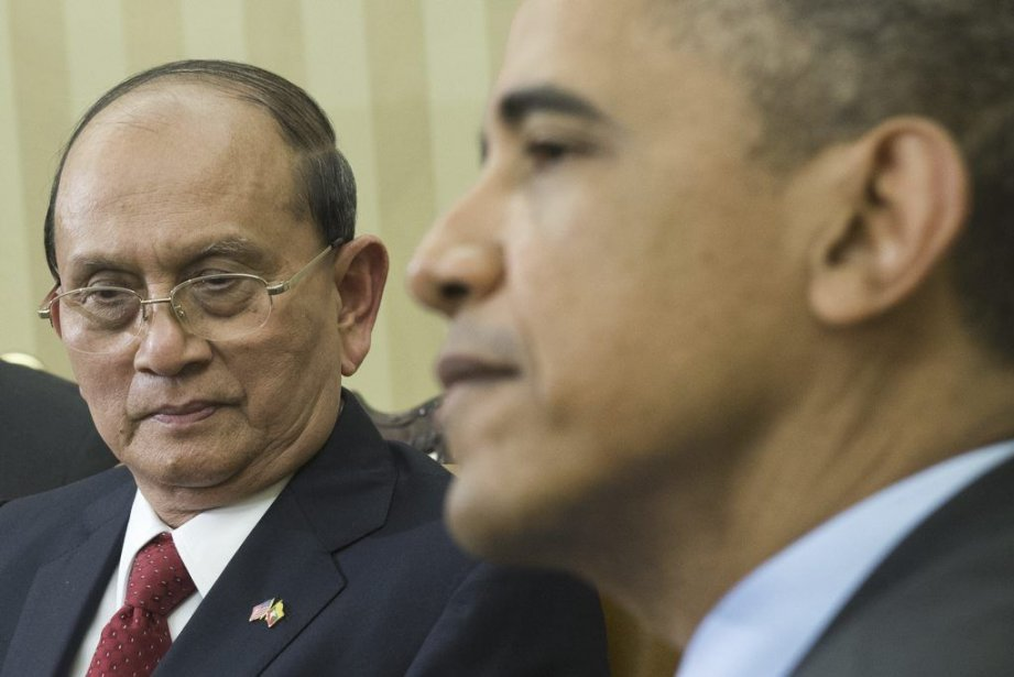 Barack Obama et son homologue birman Thein Sein,... (Photo AFP)