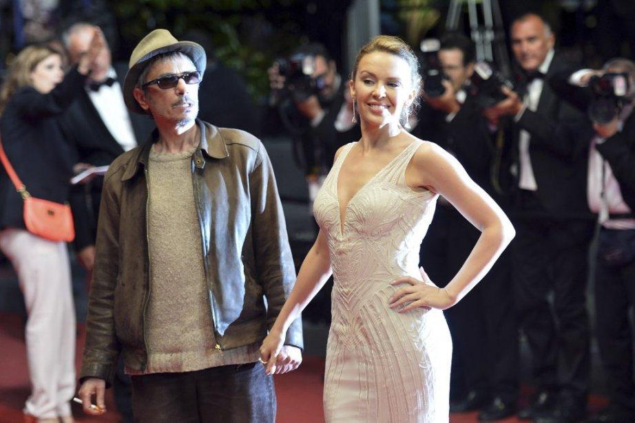 Le réalisateur français Leos Carax en compagnie de la chanteuse Kylie Minogue à la projection de «La grande bellezza». | 21 mai 2013