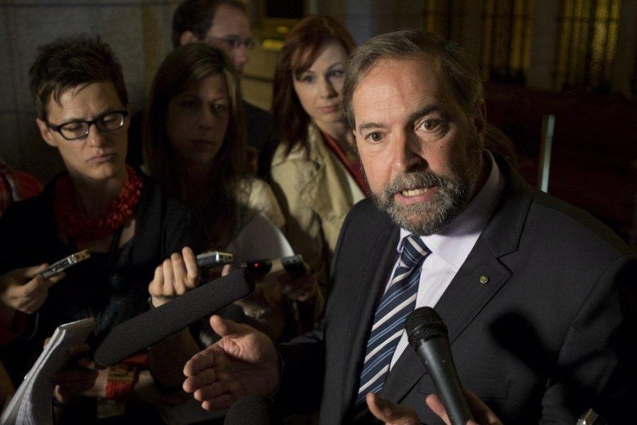 Thomas Mulcair s'est défendu de se servir du... (Photo Adrian Wyld, La Presse Canadienne)