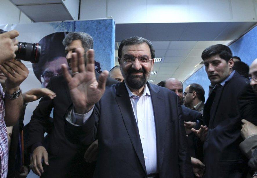 Mohsen Rezai, ancien commandant des Gardiens de la Révolution, l'armée idéologique de la République islamique.  Conservateur, il critique le bilan de l'actuel président Mahmoud Ahmadinejad. Il a promis de combattre la pauvreté, les prix élevés et le chômage. | 22 mai 2013