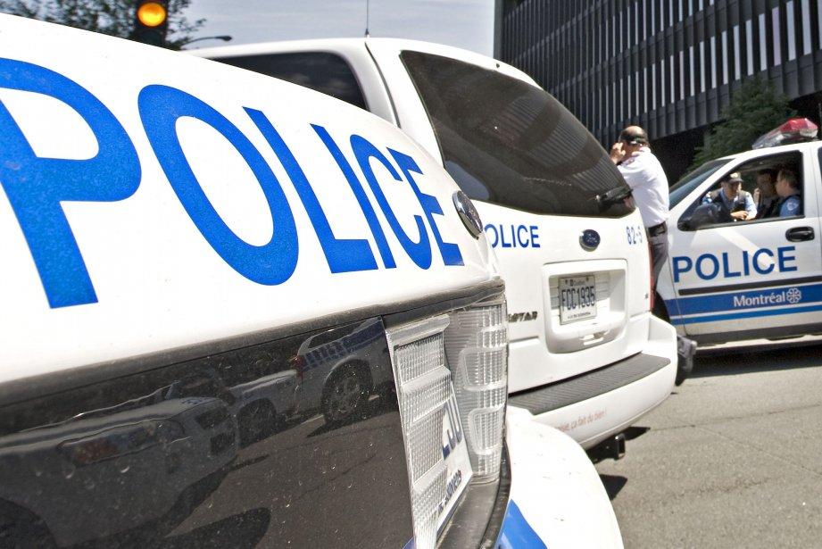 En enquêtant sur les quatre policiers du SPVM et de... (Photo archives La Presse)