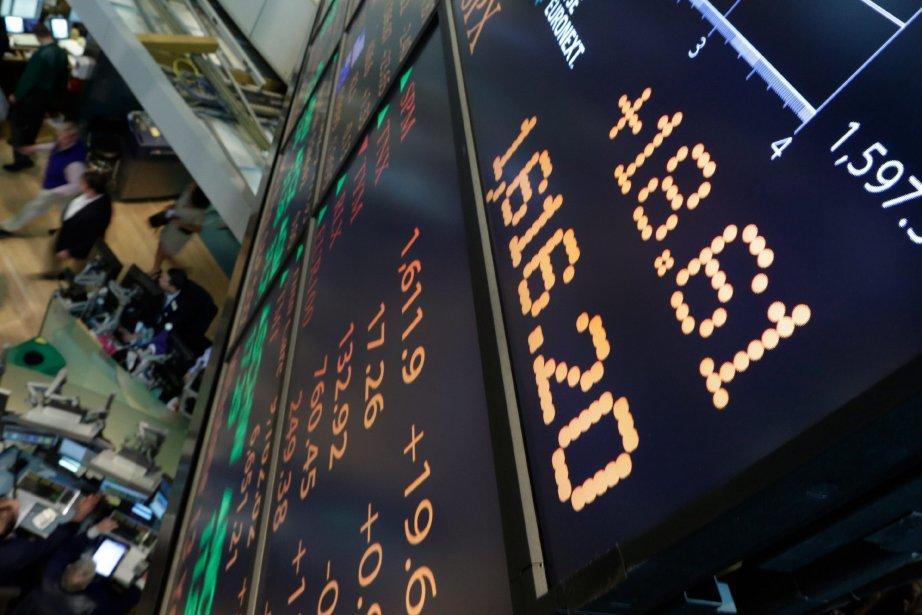 Wall Street a terminé en nette baisse mercredi, dans... (Photo Richard Drew, AP)