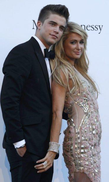 Paris Hilton en compagnie du mannequin River Viiperi. | 23 mai 2013