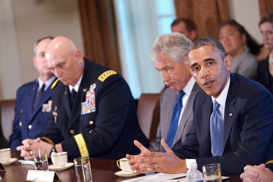 Le président Barack Obama (à droite) a demandé... (PHOTO MANDEL NGAN, AFP)